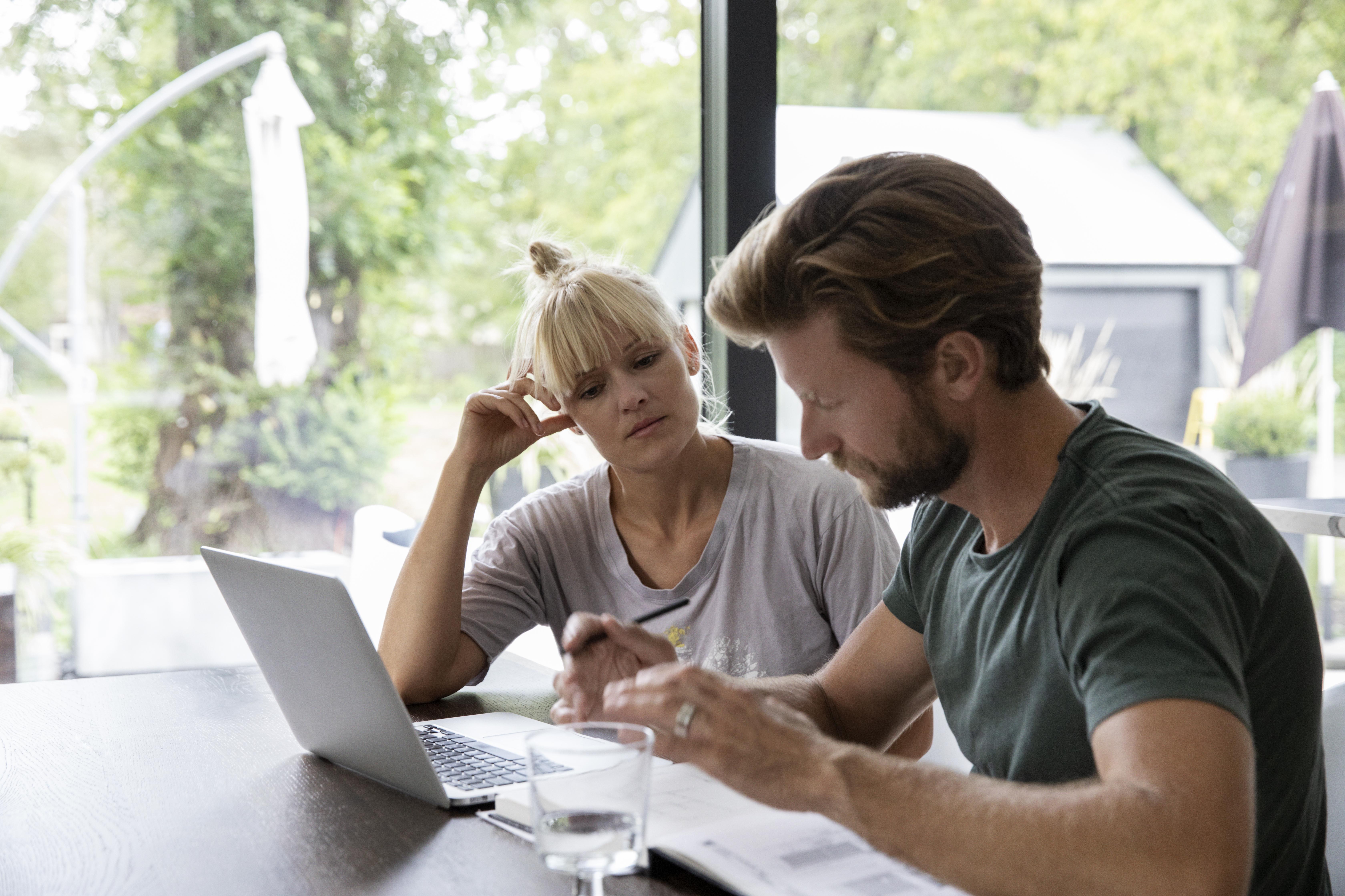 Couple reviewing portfolio documents